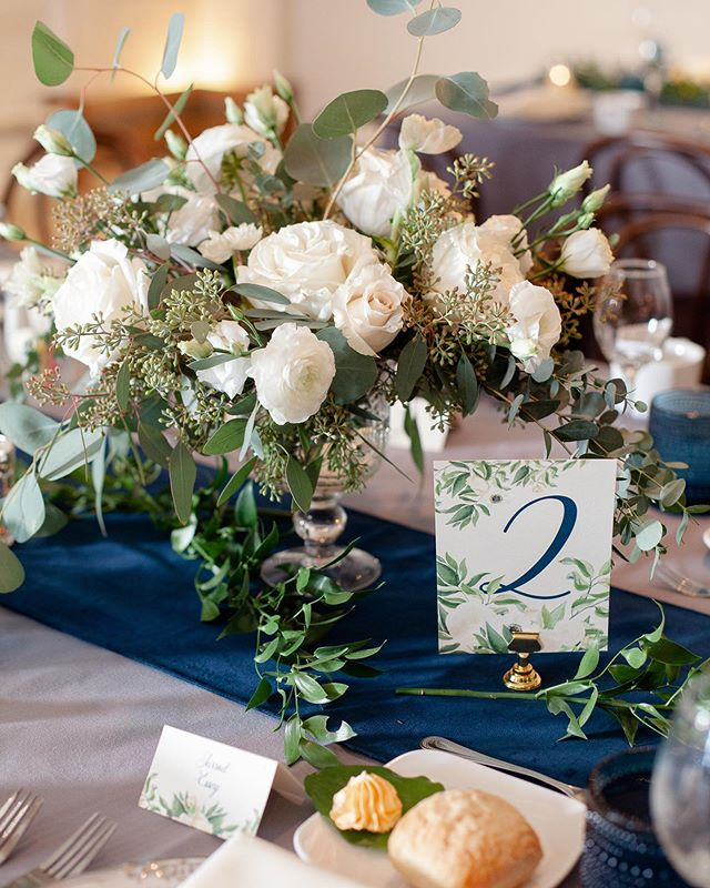 📝This is your friendly reminder to not forget about how important the wedding day stationery is in terms of your overall wedding look! 💙💙 ❇️After all that energy that went into planning out the table style (Floral Design by @thebuddingtree l Event Rentals from @borrow_curated | Event Linens from @eventsourcerental) finish it off with table numbers to match everything !  It's a small detail so often overlooked 💛| Stationery Design by @lovelysomethingsweddings l Catering by @atasteofexcellence | Live Music by @clemusicgrp l Wedding Cake by @lunacakeshop l  Photography by @jennyhaasphotography  Event Planning Allison @kirkbrides Check out the feature including details from our bride Sarah on @heyweddinglady today!! {link in bio}⭐️ https://heyweddinglady.com/midnight-blue-organic-flowers-timeless-ohio-wedding/