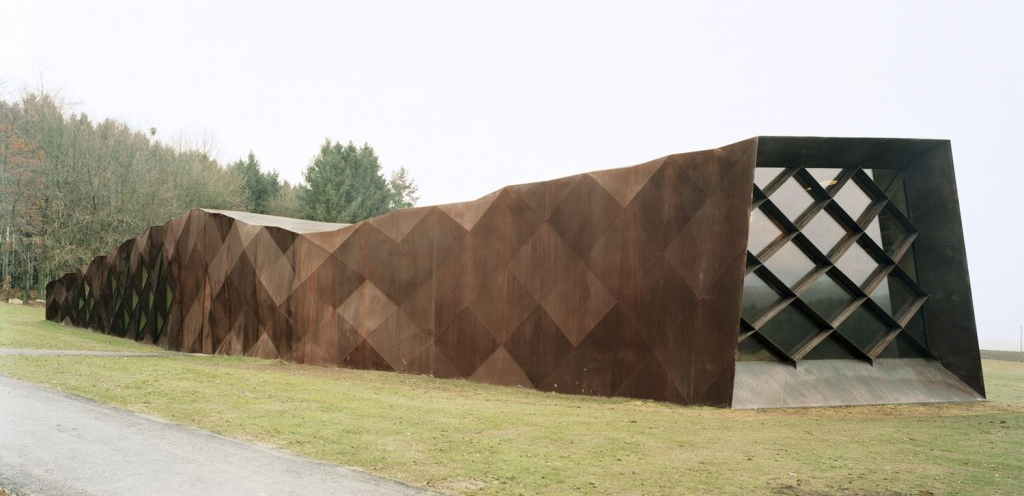 From 2 to 7 metres (6 to 23 feet) high, stretching 43 metres long, this Memorial building lies on the ground like a wounded snake. Inside are recorded stories by and about some of the thousands of prisoners who lived and died here.