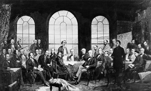 """This image, """"Fathers of Confederation,"""" from the Archives of Canada, is an artist's reconstruction of the Quebec Conference of 1864 which led to the British North America Act of 1867."""