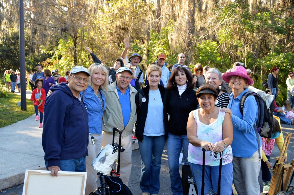 Palm Beach Plein Air group waiting for a bus after a long day at Loxahatchee painting competition.