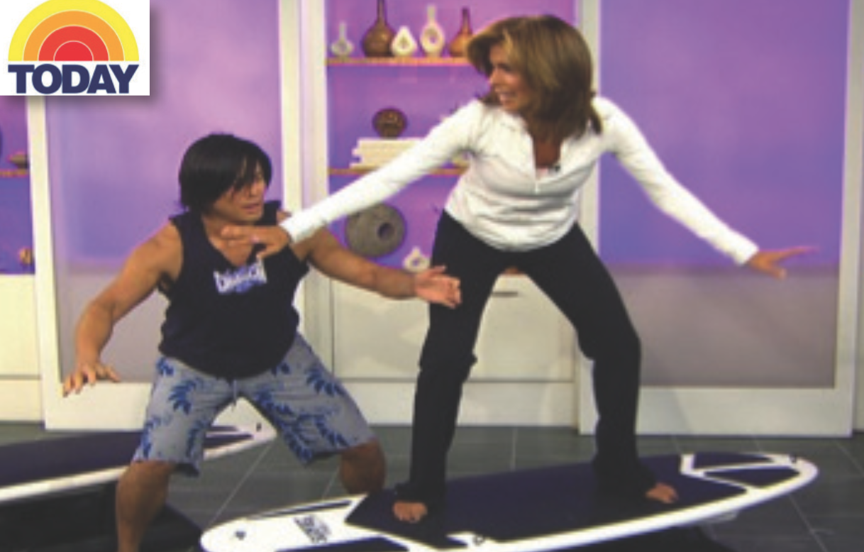 On the Today Show teaching Hoda Kotb a class surfing inspired workout.