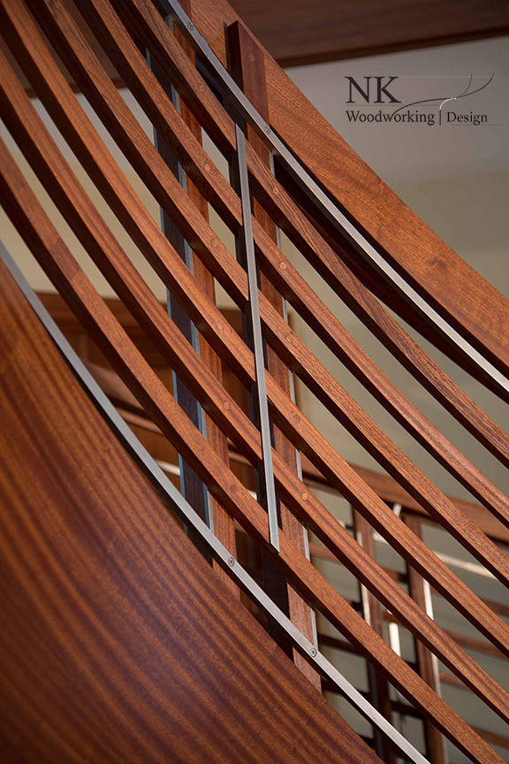 NK Woodworking Floating Curved Stair in Sapele and Stainless Steel