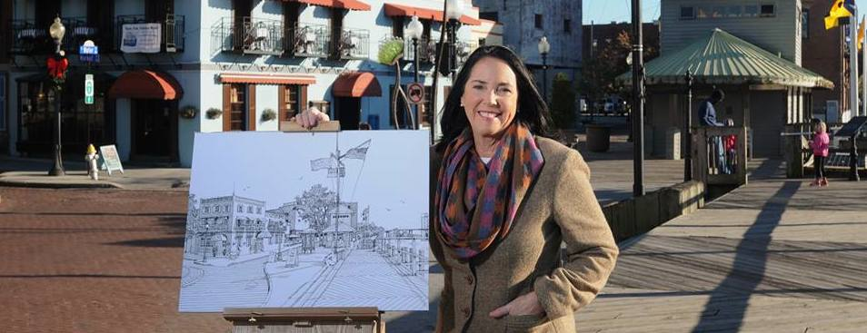 """I am pictured here with the drawing which was featured on the Star News Media Commemorative Cup for 2013. It is titled """"The Foot of Market Street."""""""