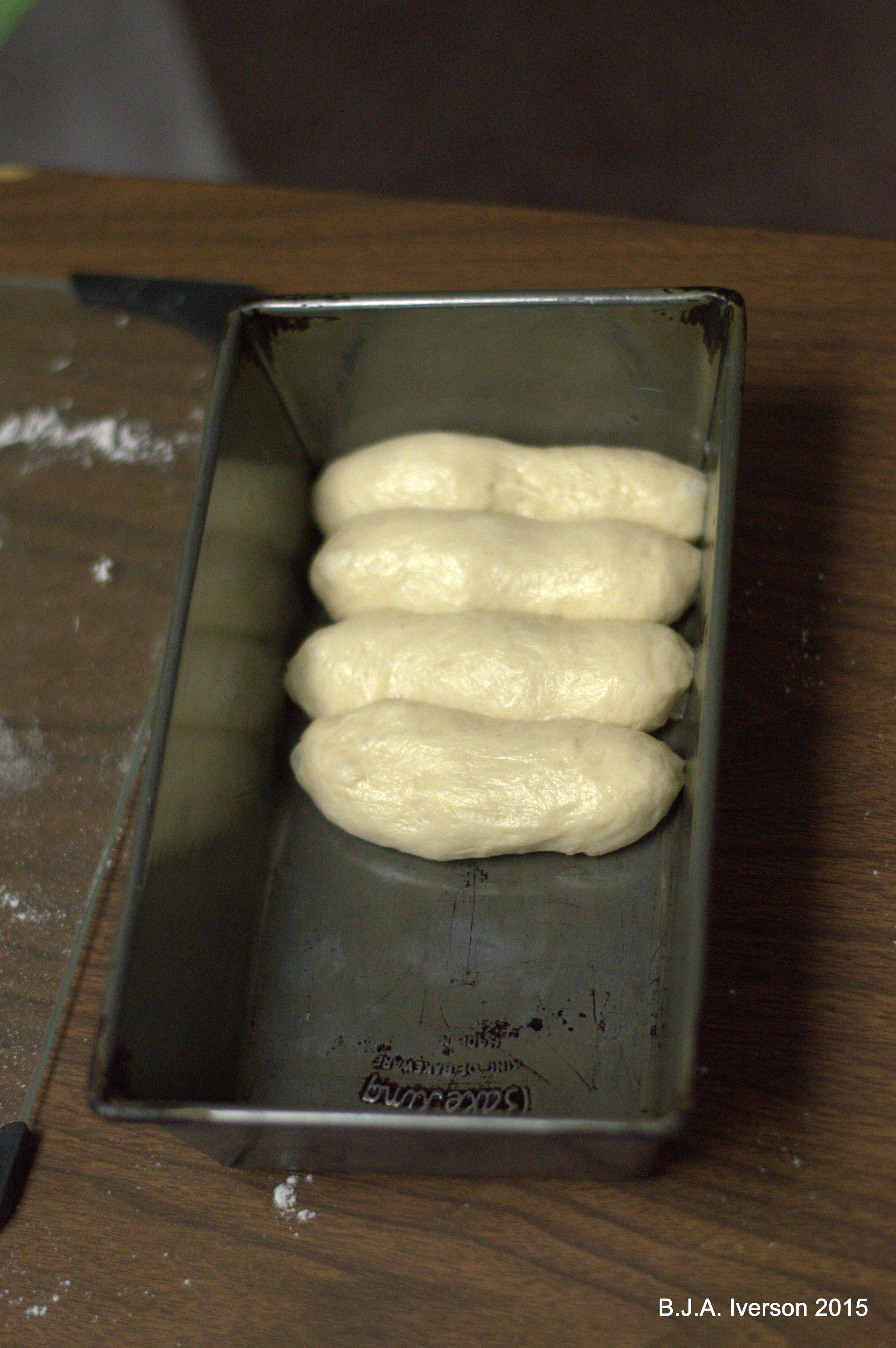 One loaf pan will hold 7-8 finger rolls.