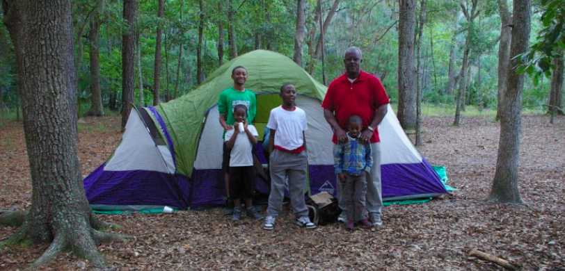 Four of the young men with their tent leader, Mr. Dan Metts.
