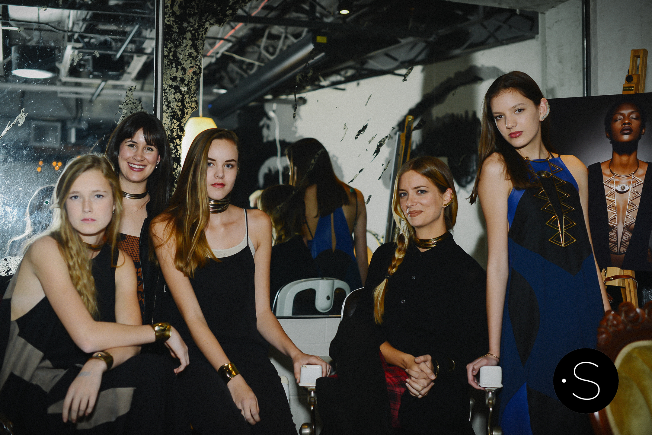 """Amanda Valentine and Mclaine Richardson of Margaret Ellis Jewelry with models, Caroline, Keegan and Reese, at The Cellar at The Sutler during the""""Roman Holiday"""" Party."""