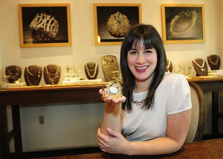 Mclaine Richardson is the new owner and designer of Margaret Ellis Jewelry, appointed in 2013 by the brand's retired founder. Richardson hopes to continue the tradition of fine handcrafted jewelry.   Photo: Larry McCormack | The Tennessean  Mclaine is holding the  Concentric Circle Pearl Cuff