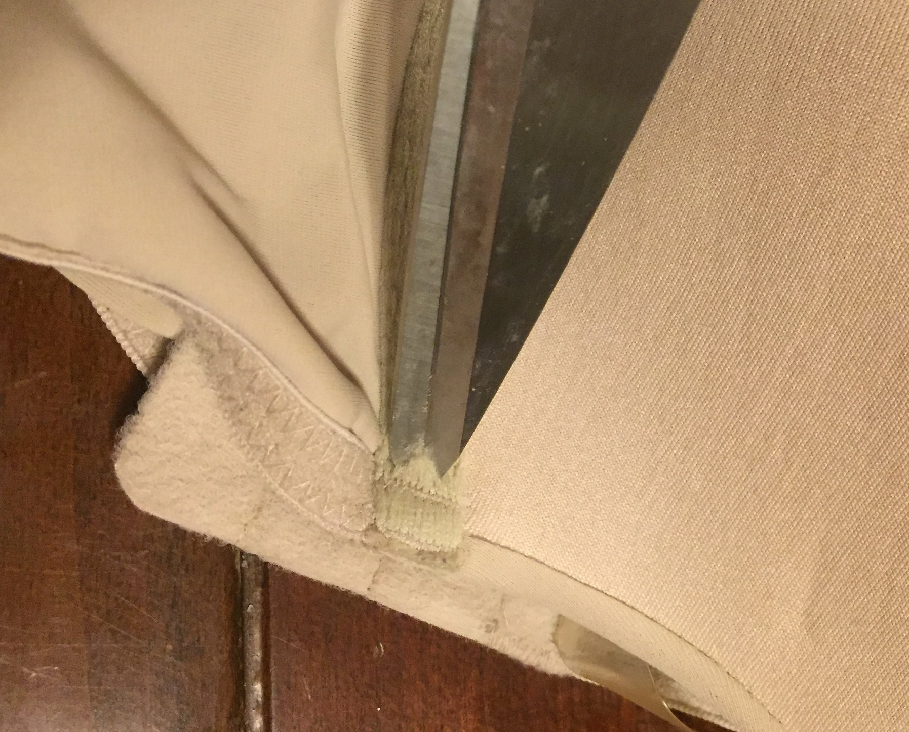 Find the end of the underwire and make a snip in the fabric.