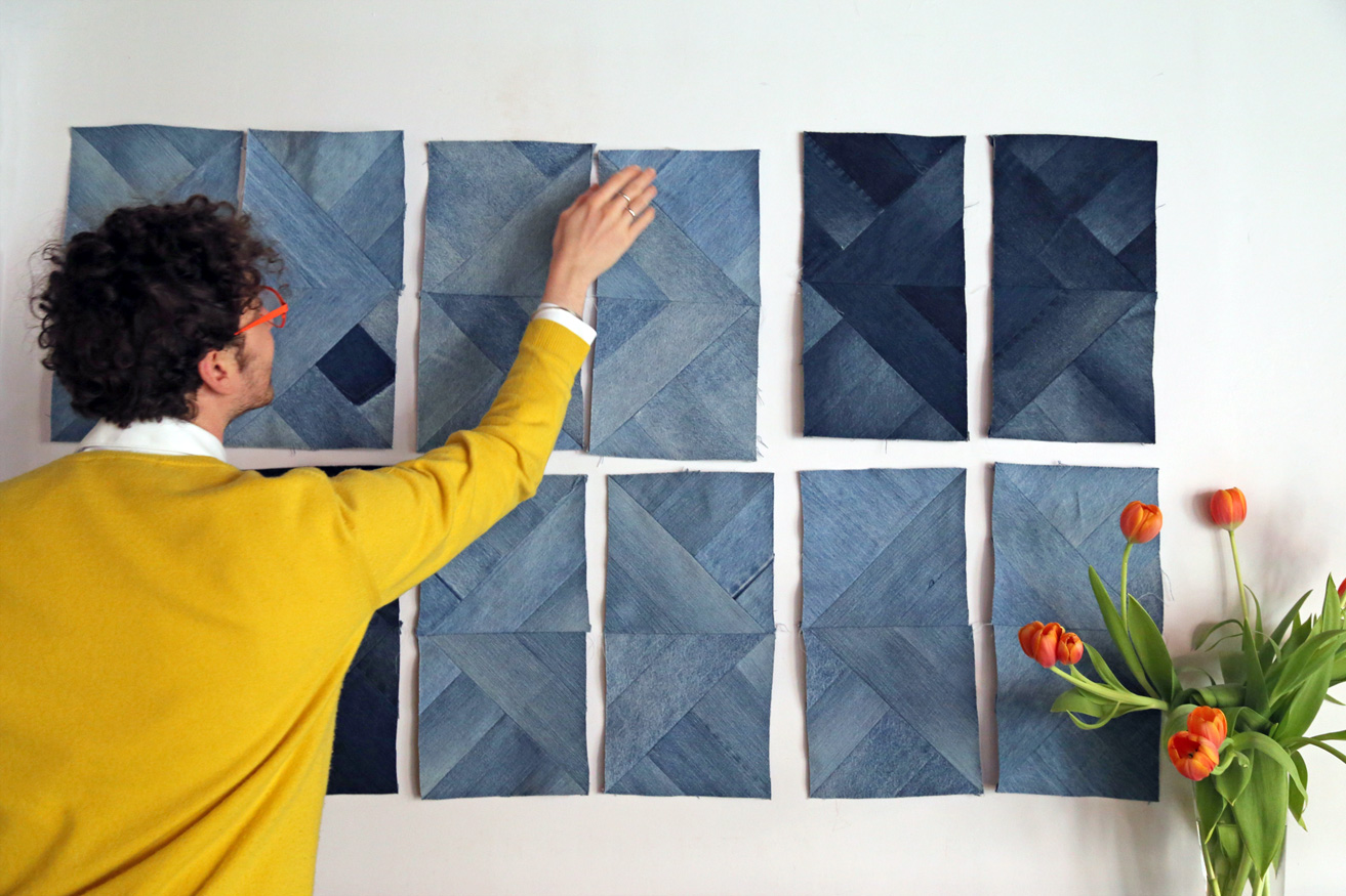 David piecing together patchwork panels for the vintage denim upholstery fabric we are making to cover our studio lounge. It is a humongous project and will be a super comfy piece to rest on once we are done.