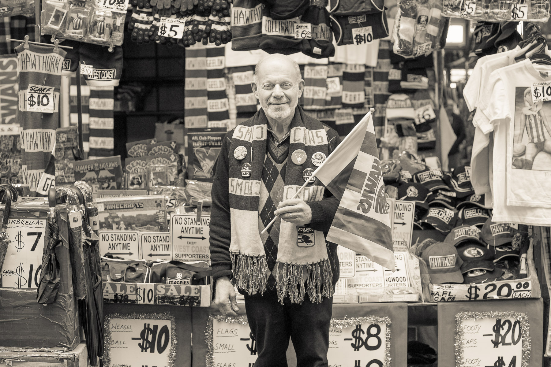 Footy paraphernalia market trader, Graeme. Photograph by  Emma Byrnes.