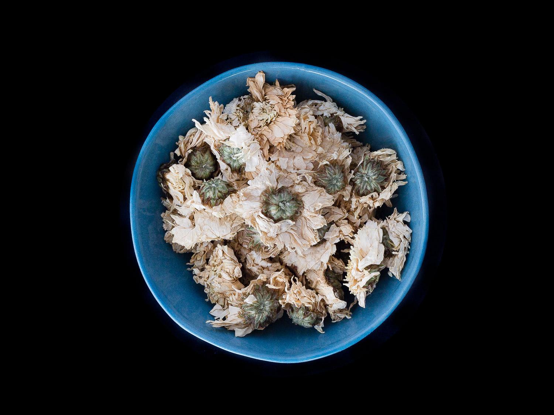 Chrysanthemum flower tea  in beautiful ceramic bowls by  Marmoset Found.  Photograph by  Emma Byrnes.