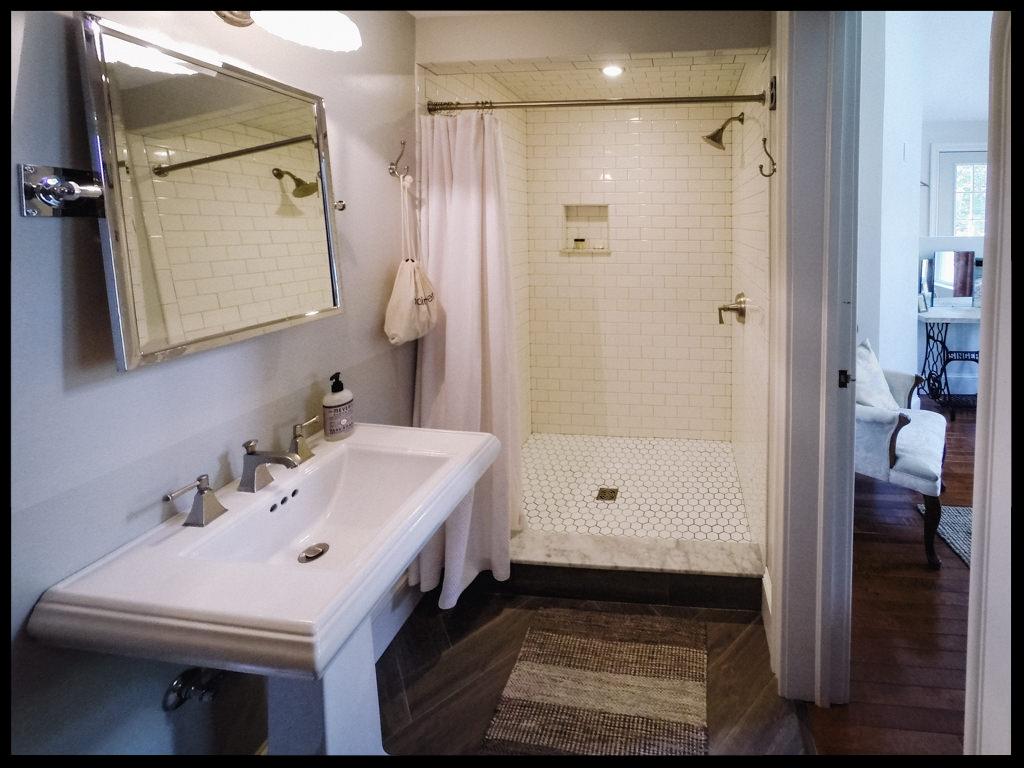 Excelsior bathroom with tile shower and pedestal sink