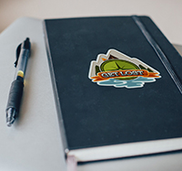 Get Lost Vinyl Sticker on notebook cover