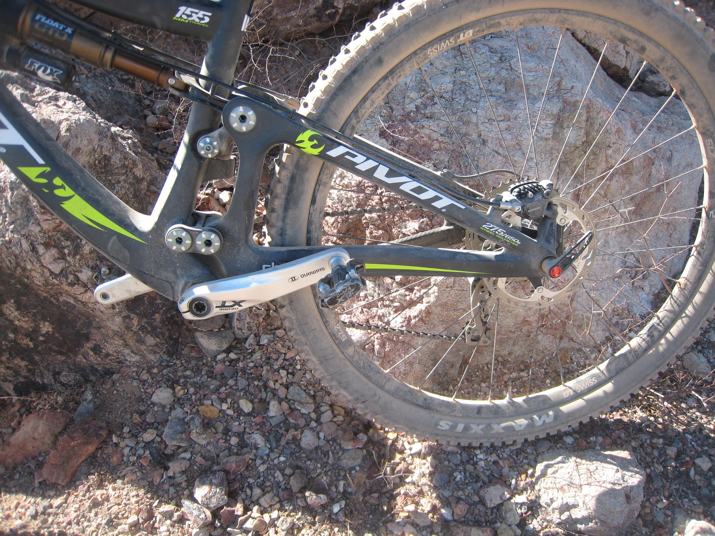 Dw-link suspension has an initial rearward travel to reduce suspension squatting.