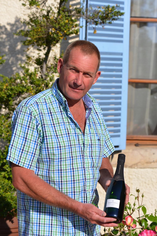 Julian Barnes with his sparkling cuvee 'Biddenden Pinot Reserve' 2010, at Les Deux Chevres, Gevrey Chambertin, Burgundy