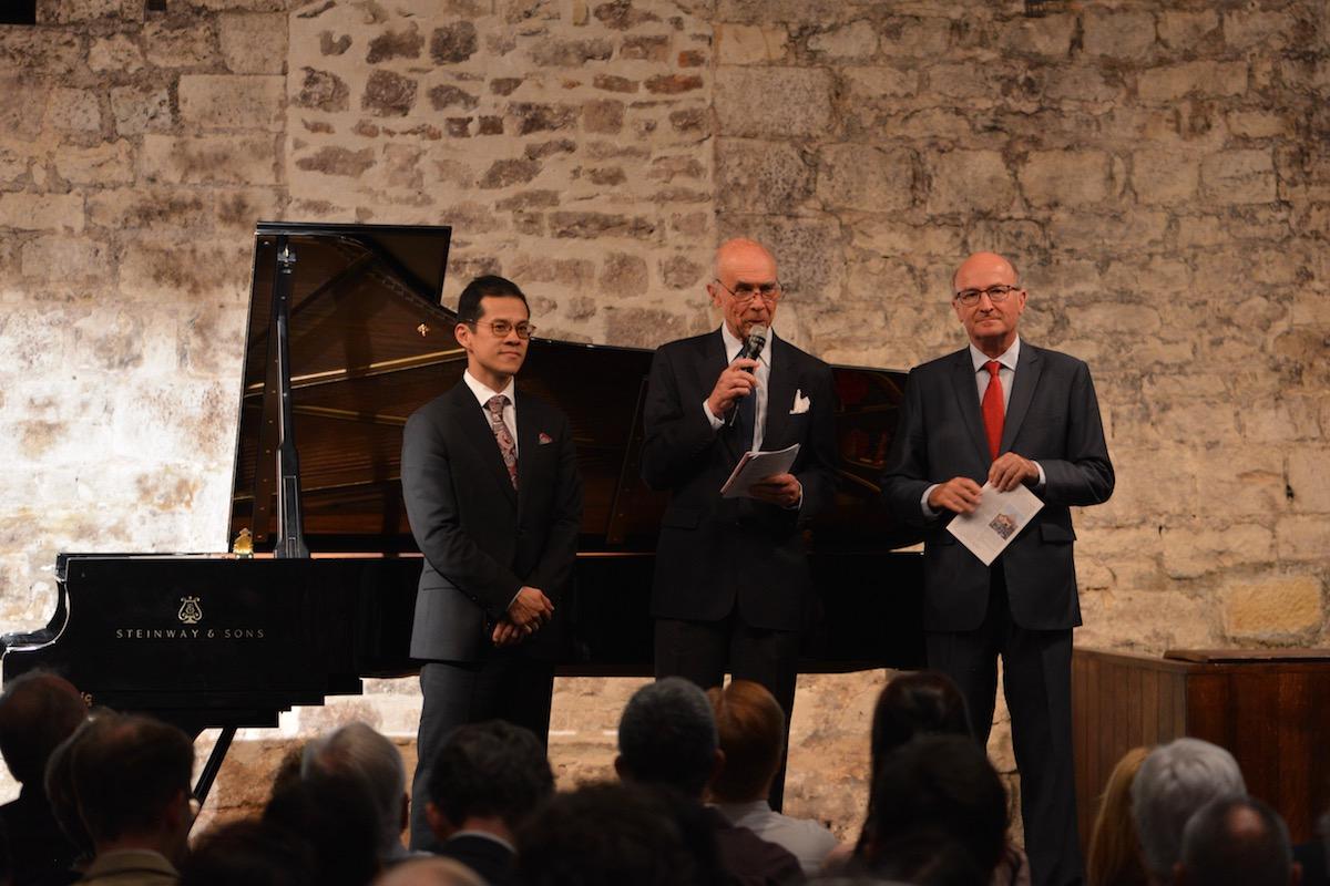 left to right, David Chan of the New York Metropolitan Orchestra, Aubert de Villaine of Romane-Conti, and Bernard Hervé