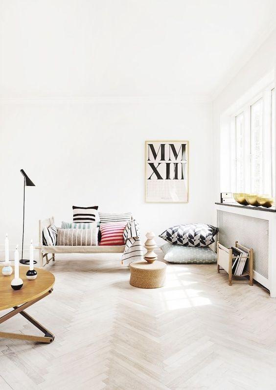 Herringbone floors add timeless elegance.  Photo Source