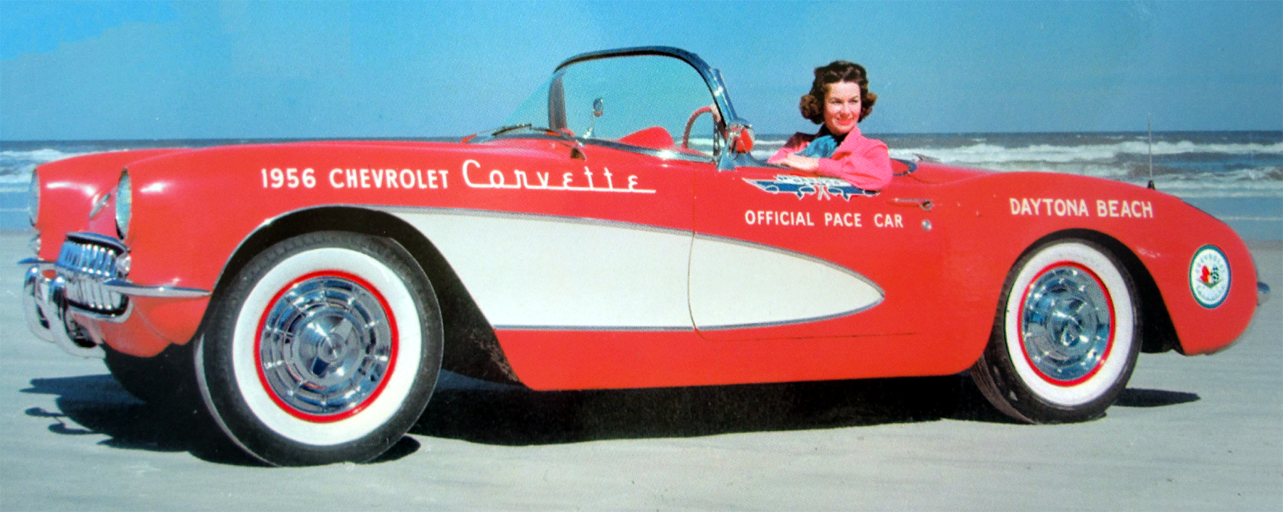 In three short years, Corvette had become a racing success story and on its way to being an American Legend. Sporting NASCAR's logo, here's the official '56 pacecar with racer Betty Skelton; also notice HJE's Corvette round logo behind back wheel.
