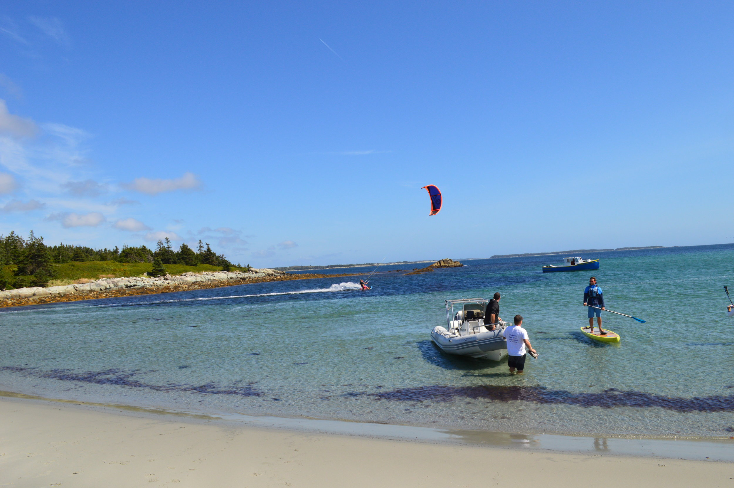 Kitesurfer Mark Moore, Jan LaPierre of A for Adventure, Joel and Travis helping to ferry everyone to shore from Brian Murphy's Boat!