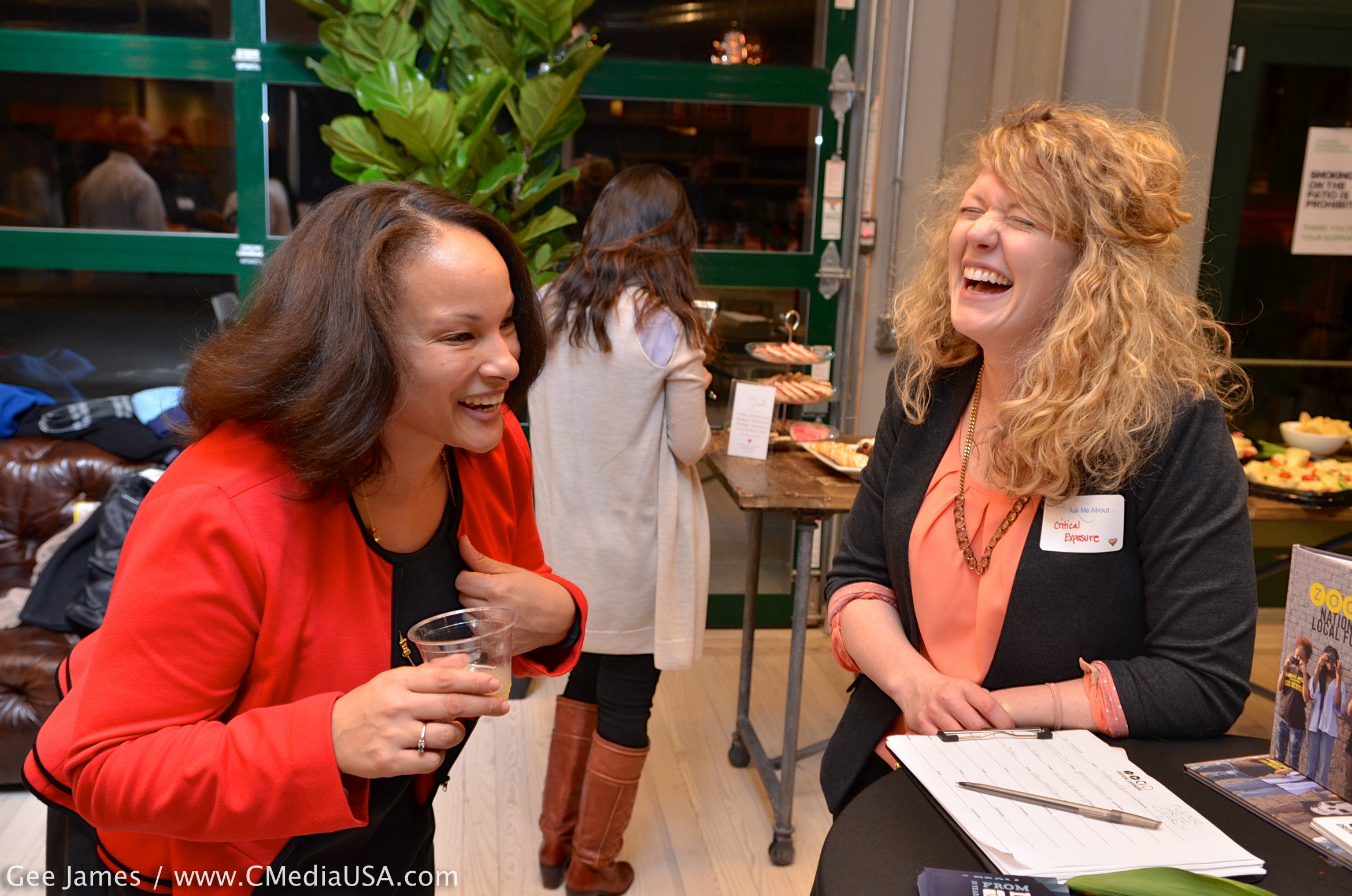 Jacquelyn Horstmann of Critical Exposure shares a laugh with Camille Harris, a board member with the ClancyWorks Dance Company/Photo by Gee James for Capitol Media