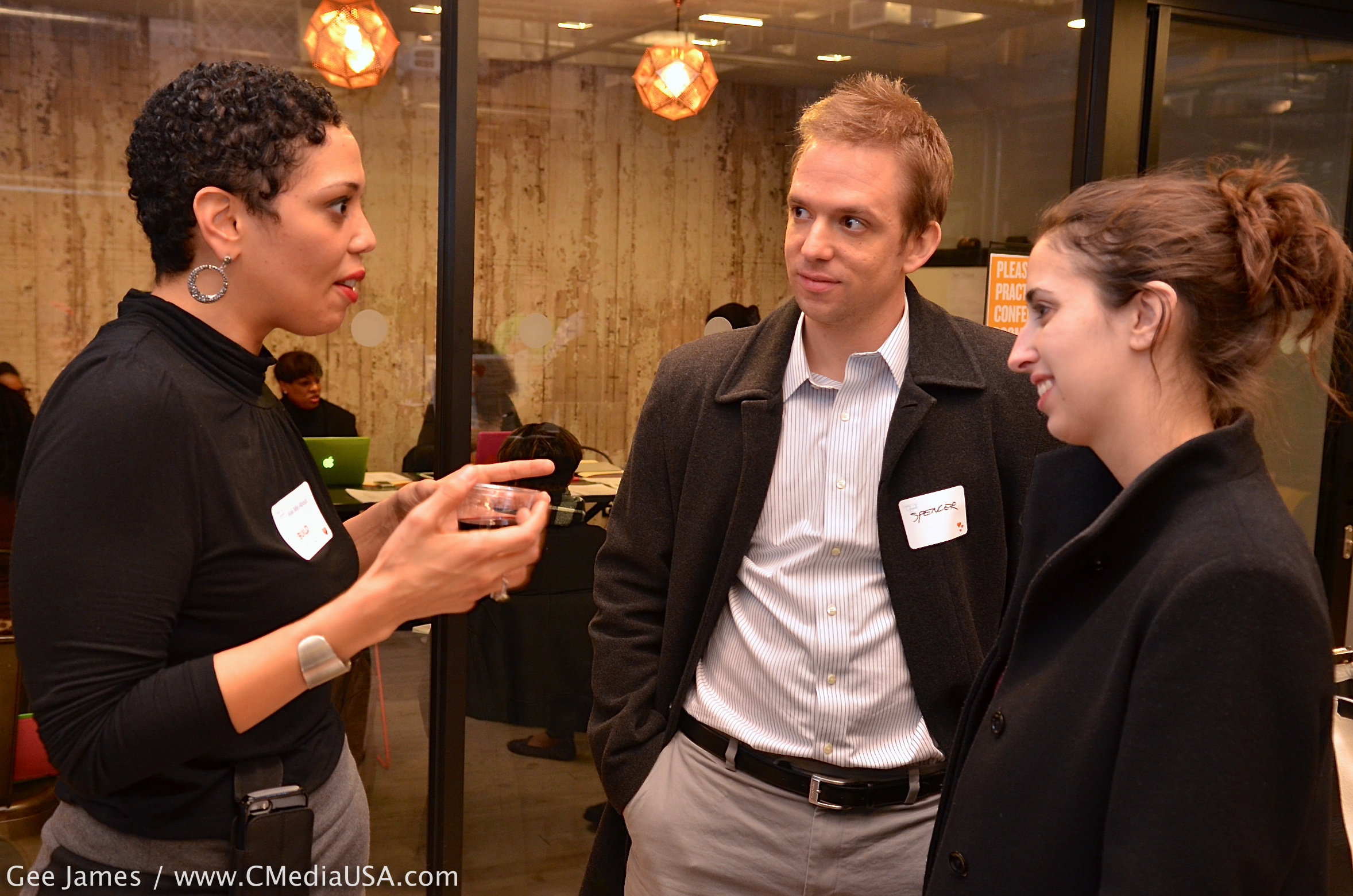 """Natalie Benitez, program manager for BUILD, talks with Spencer Case and Rebecca Wolff. """"We're looking to help make the world a better place,"""" Spencer said./Photo by Gee James for CapitolMedia"""