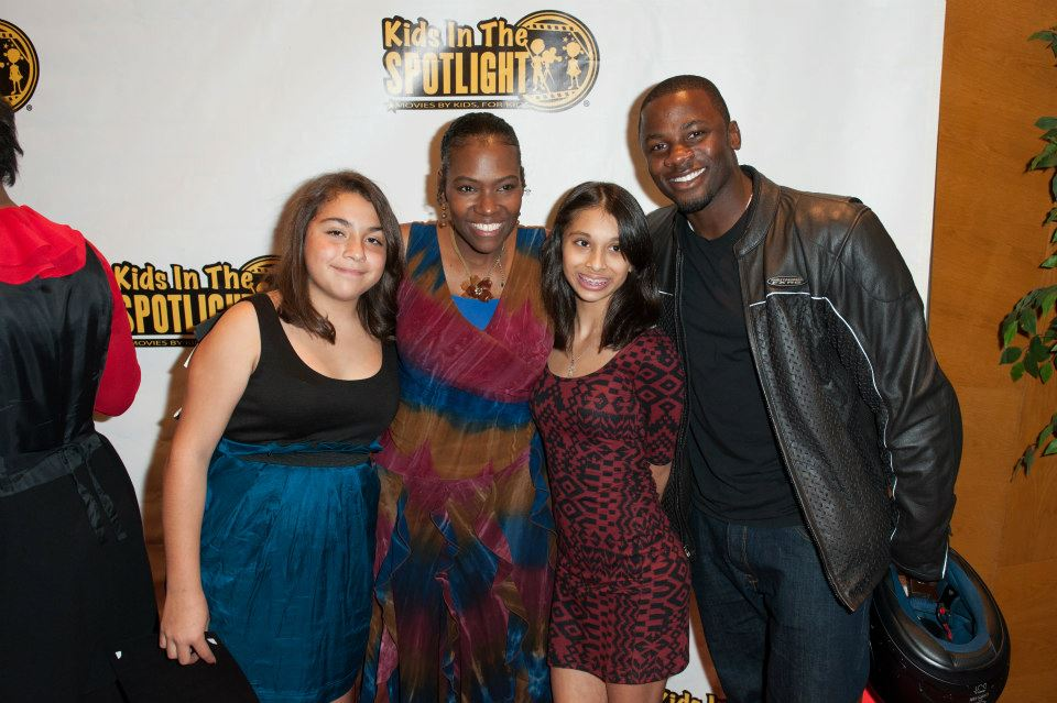 Founder Tige Charity with KITS participants and actor Derek Luke