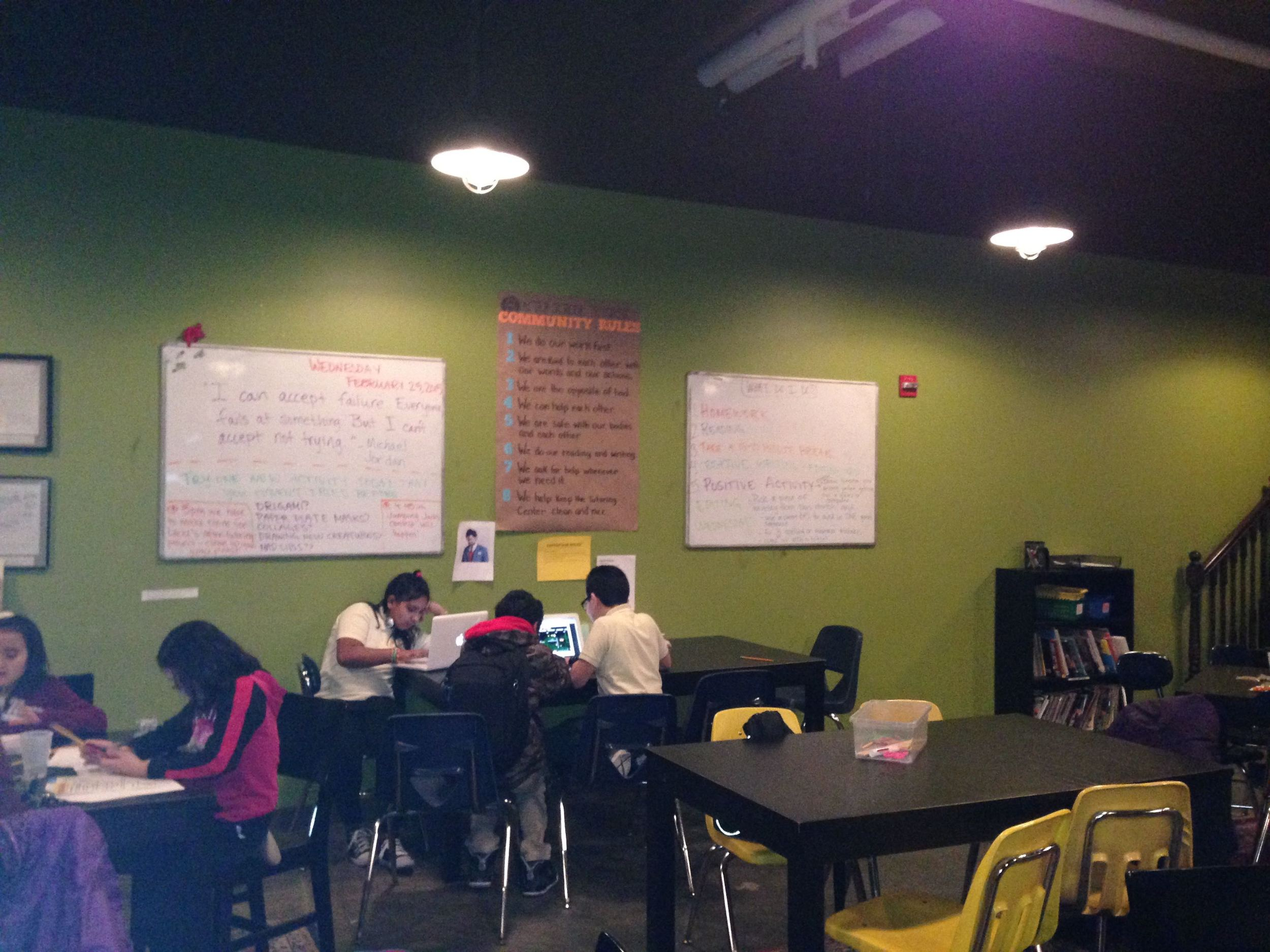 826DC students work with tutors during an after-school session.