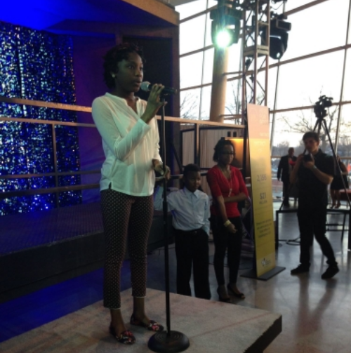 """Raymani, astudent from  Higher Achievement ,reads an original work of poetry centered on the theme of love. Higher Achievement works to """"close the opportunity gap"""" for middle school youth in DC. """"Before Higher Achievement, I never had opportunities like this,"""" she said."""