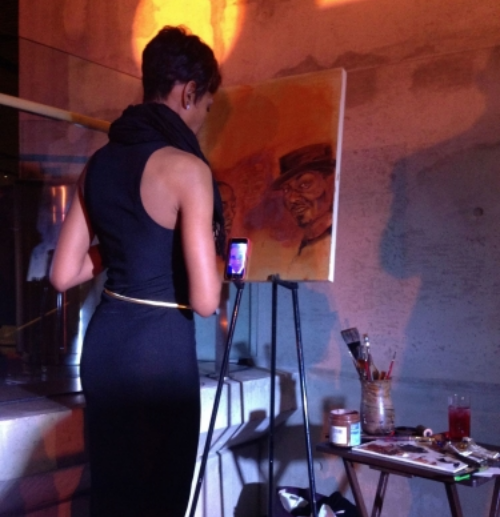 "DC emerging artist  J'Nell Jordan  paints as part of the Gallery for Good. In her artist's statement, Jordan noted that she loves to capture  ""feel good""  moments."