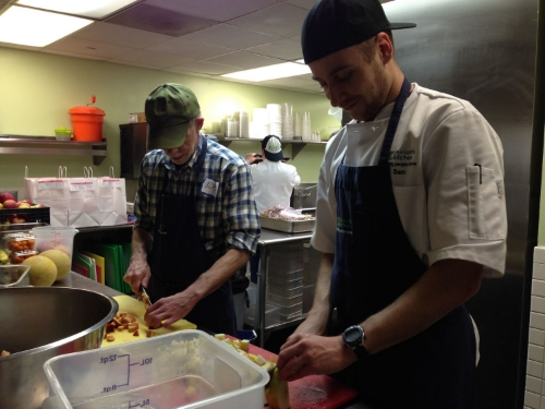 Volunteers help prepare dinner at Miriam's Kitchen