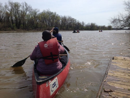 Piloting a two-person canoe requires both paddlers to communicate with, and depend on, each other.