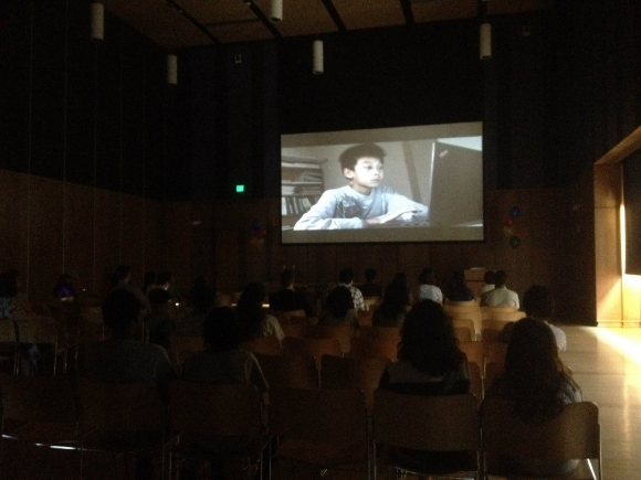 A film is shown at the Gandhi Brigade Youth Media Festival