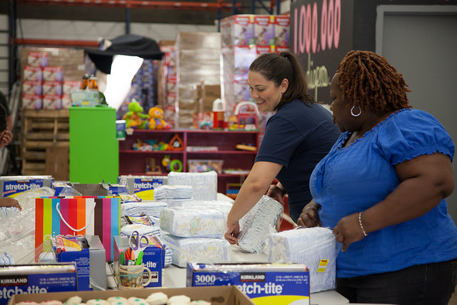 DC Diaper Bank executive director Corinne Cannon bundles diapers with a volunteer./ Photo courtesy of DC Diaper Bank