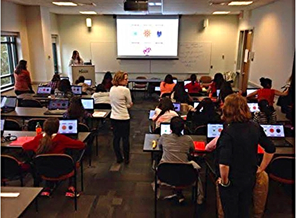 Volunteers lead a coding workshop/ Photo credit: DC Web Women