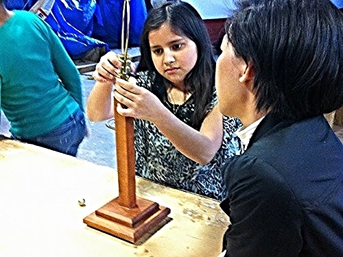 A SOHO student and mentor work on a lamp/   Photo source: Patch.com