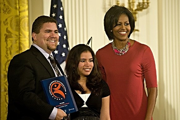 YPT student Mariana with then-CEO David Andrew Snider and First Lady Michelle Obama, 2010/Photo Source: Young Playwrights Theater