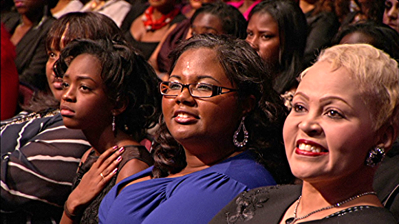 """ScholarCHIPS founder and executive Director Yasmine Arrington (center) being honored at 2012's """"Black Girls Rock"""" event."""