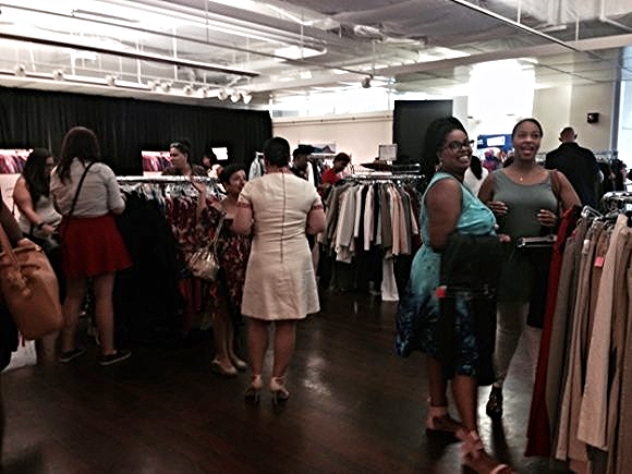 Guests browse the racks at the Goodwill Edited Summer Trunk Show, co-hosted by the Young Professionals Council.