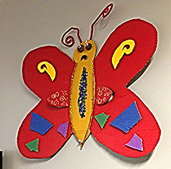 A colorful cardboard butterfly hangs on the wall of Allen's office. It symbolizes new beginnings.