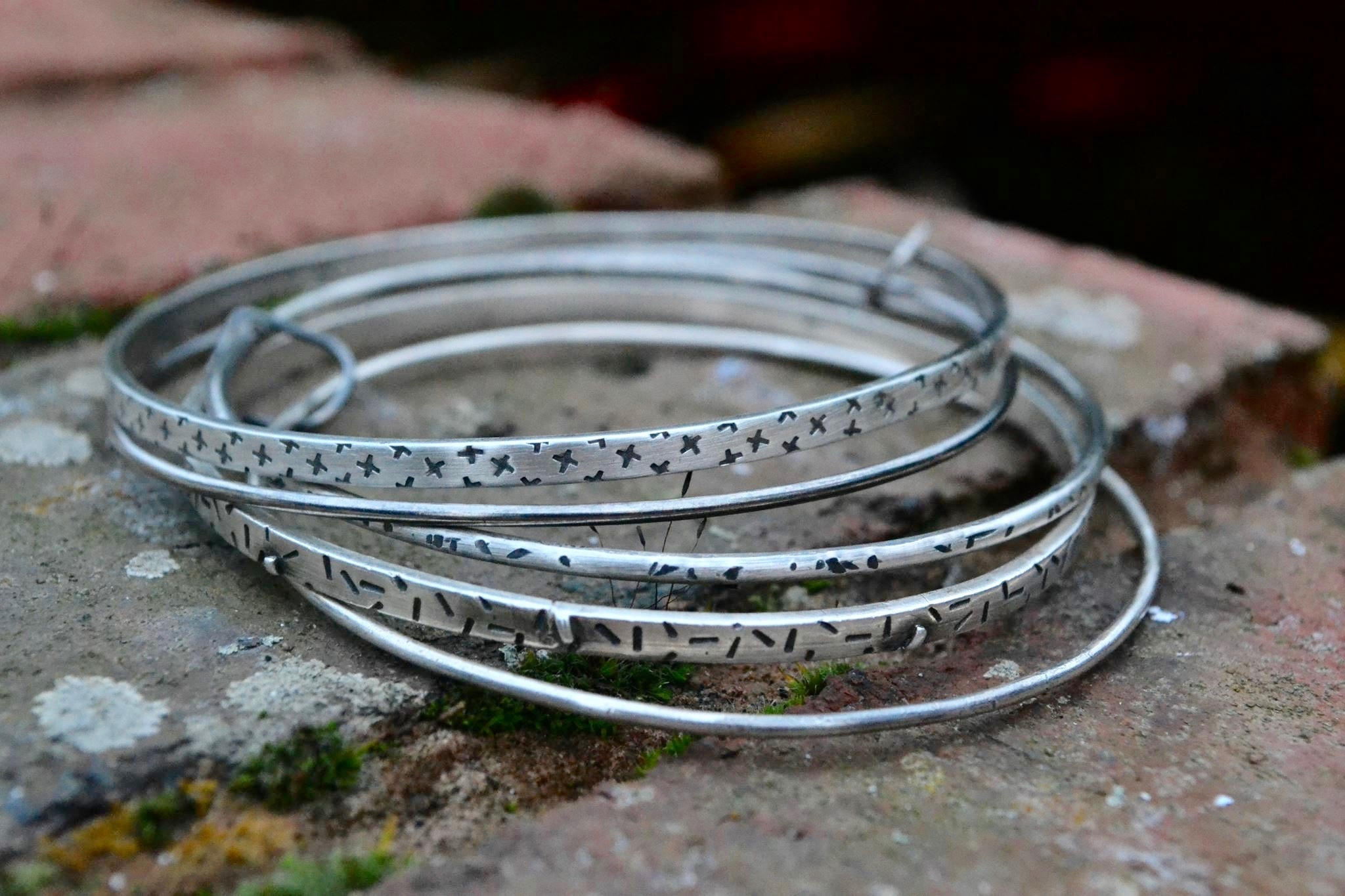 Sterling silver textured Bangles. available in different sizes and a range of different textures pricing   from £95 -£180