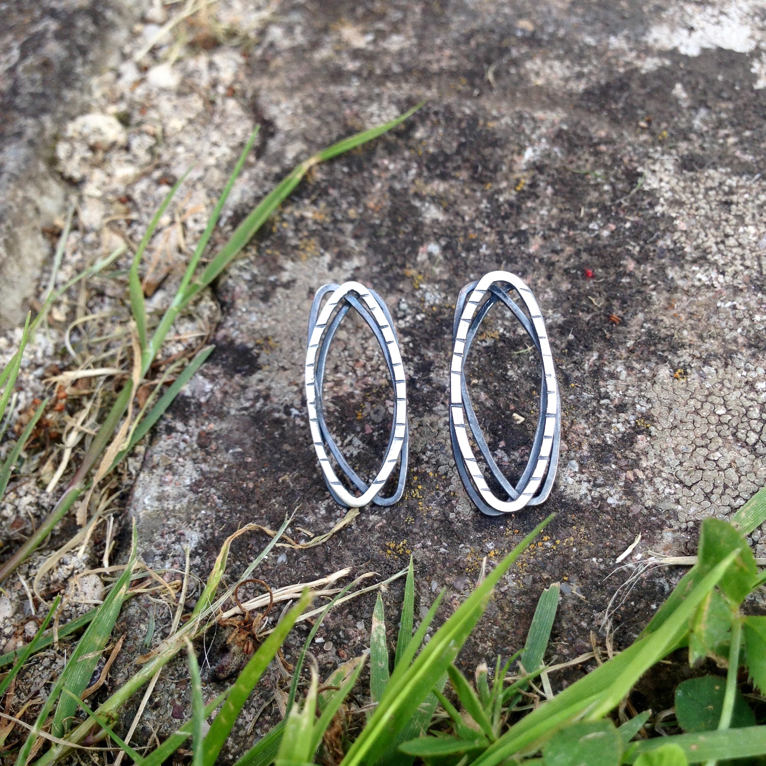 Sterling silver layered wire studs.