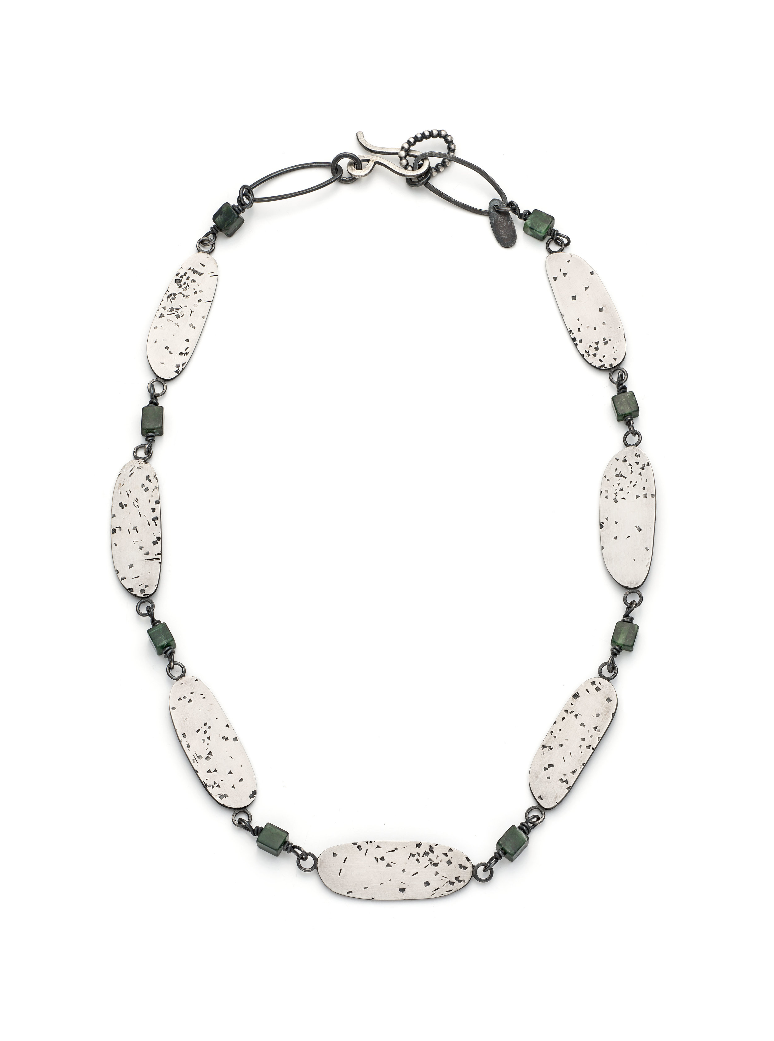Large sterling silver statement necklace with royal green semi precious beads with seven large freckled textured ovals. £340