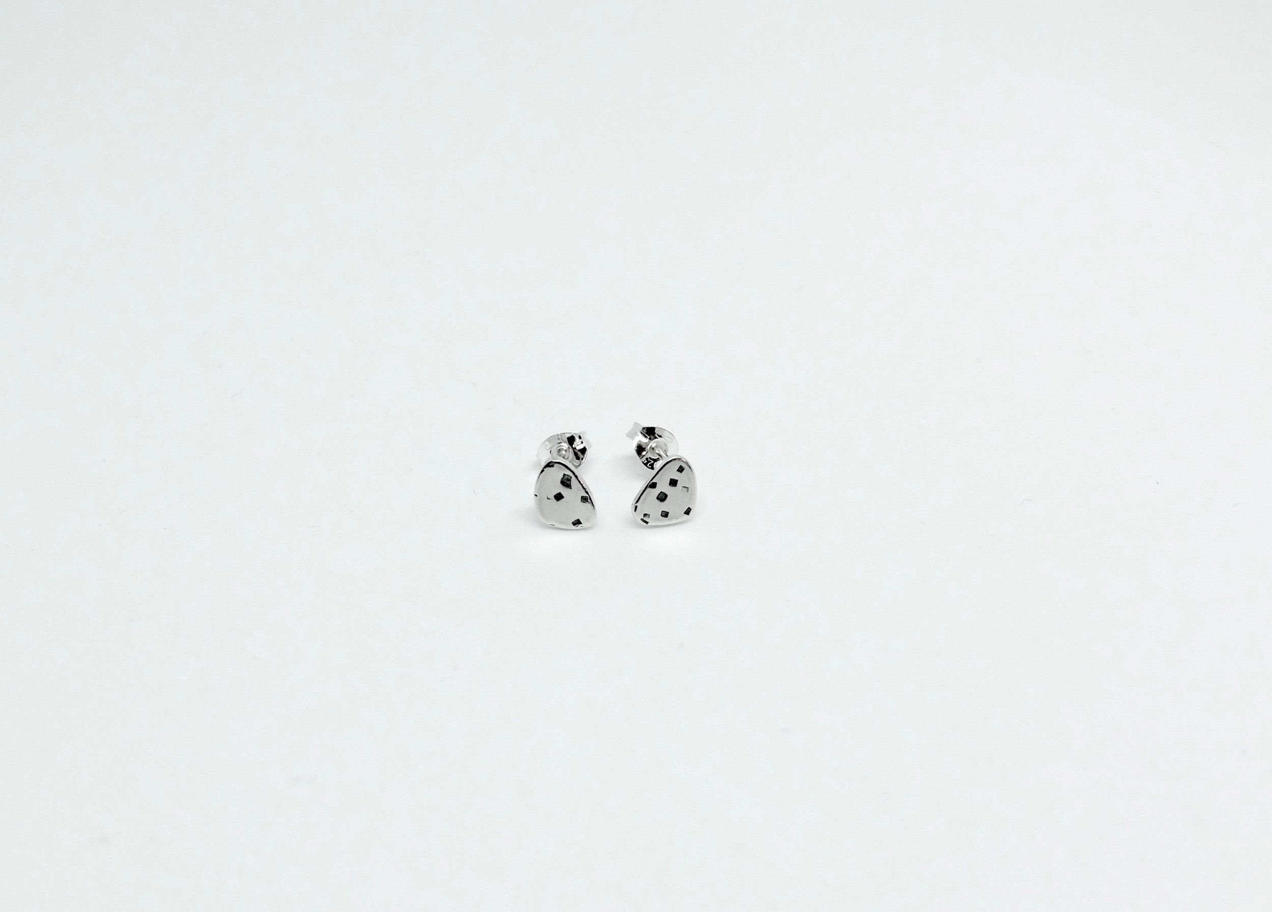 XS Sterling silver freckled texture studs. Available in XS,S,M,L,XL