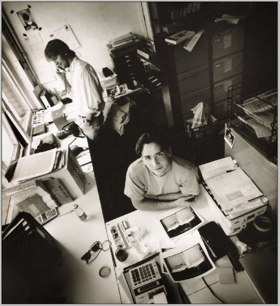 Insight Photographers - Coronet Street, London N1 - 1989 Jez Coulson and I hanging amongst the many filing cabinets full of prints and negatives. Photograph by Neil Turner.