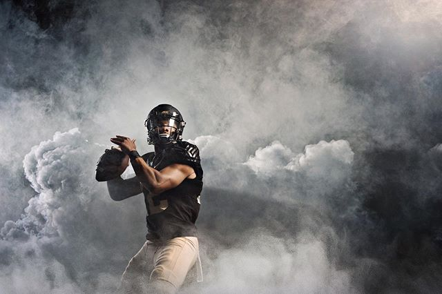 THE SMOKE IS REAL 😎#collegefootball season is well underway. Here's a shot from my shoot with @wakeforestofficial #football. That's #americanfootball to my #fellowbrits. This was captured inside @wakeforest_athletics indoor training facility in #winstonsalemnc. Shot with my @nikonusa using @profotousa lights along with a @eg_usa #cloudmaker #cm75 They packed a nice collection of cloud etched out with back and #toplighting. . . . . . . . #demondeacons #demondecons🎩 #collegefootballsaturday #advertisingphotography #collegepromo #nike #gameday #nfl #tailgate #profoto #nikon #nikon70200 #pocketwizard #sportsphotography #actionphotography #enolagaye #enolagayeusa #m18 #smokegranade #fitness #bazzajholmes #barryjholmesphotography