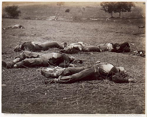 Timothy O'Sullivan,The Field Where General Reynolds Fell, Gettysburg, Pennsylvania, silver print, 1863; among other things, this photograph anticipates the dethroning of documentary illustration, then nearing its height in the Civil War era; from a purely visual perspective, the image highlights the new pictorial sensibility of the machine: the focus on the corpses brings the viewer's gaze down, very nearly past the horizon line, opening up an abstract field of composition unconcerned with the grand pictorialism of declamatory history painting–instead, a grittylook-at-that!as well as a new kind of two-dimensional design for images