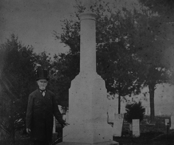 The top-hatted colonel standing next to his monument. He looks older. Seems likely to have been shot around 1880.
