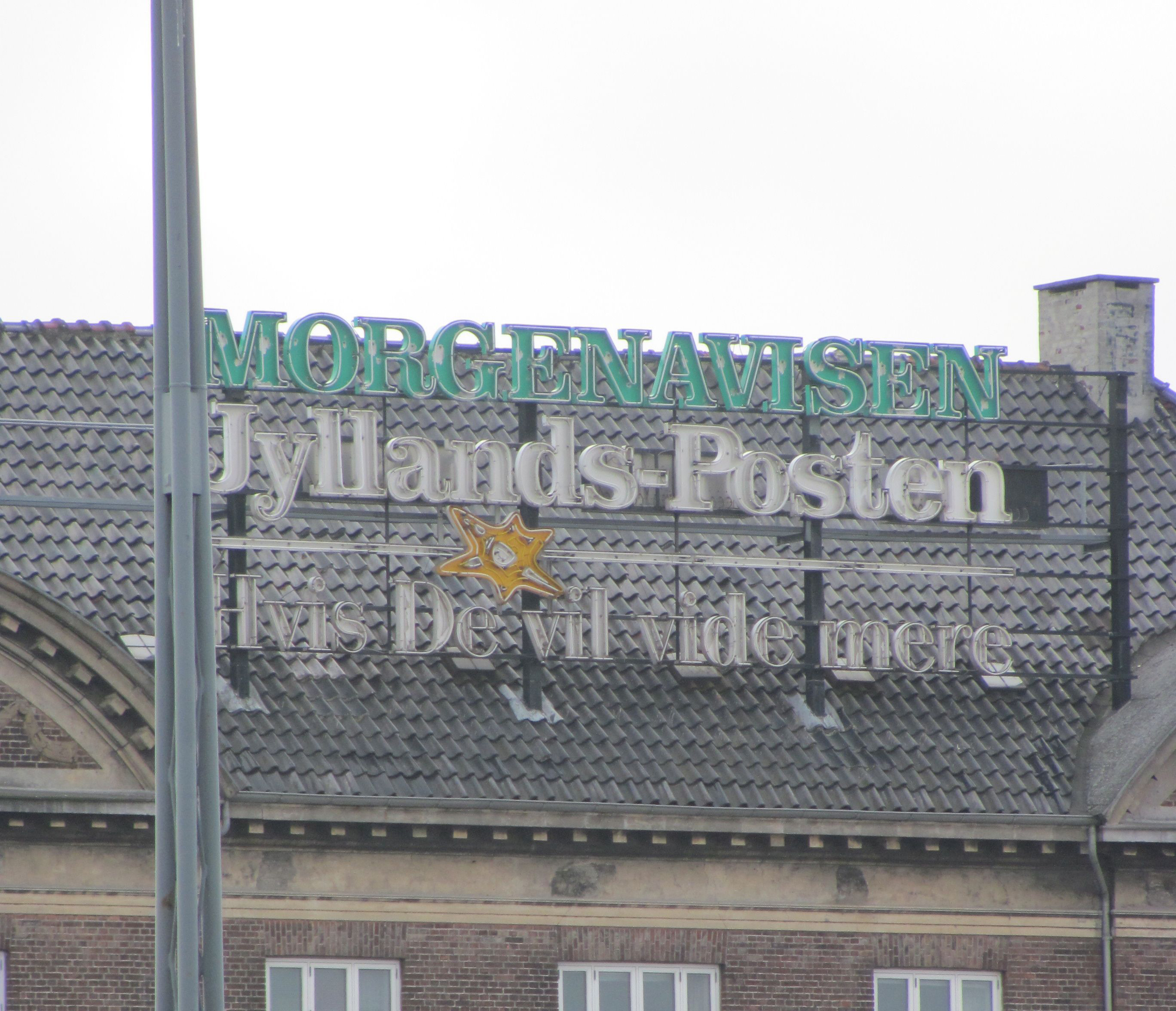 Neon signage (no longer illuminated, probably for security reasons) identifying the offices of Jyllands-Posten in Copenhagen. I shot this photograph in 2011.