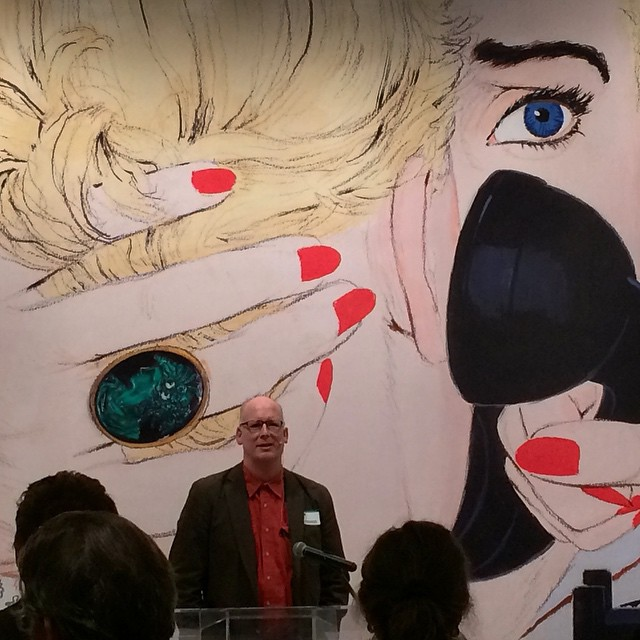 Your Truly, speaking in front of a giant reproduction of a Mac Conner illustration. If you go to the show, which Iurge you to, here's sometreasure hunt fun:go find thisactual illustration and look at that ring: what's surprising about it?  Photograph by Deep Dutta . (Thanks, Deep!)
