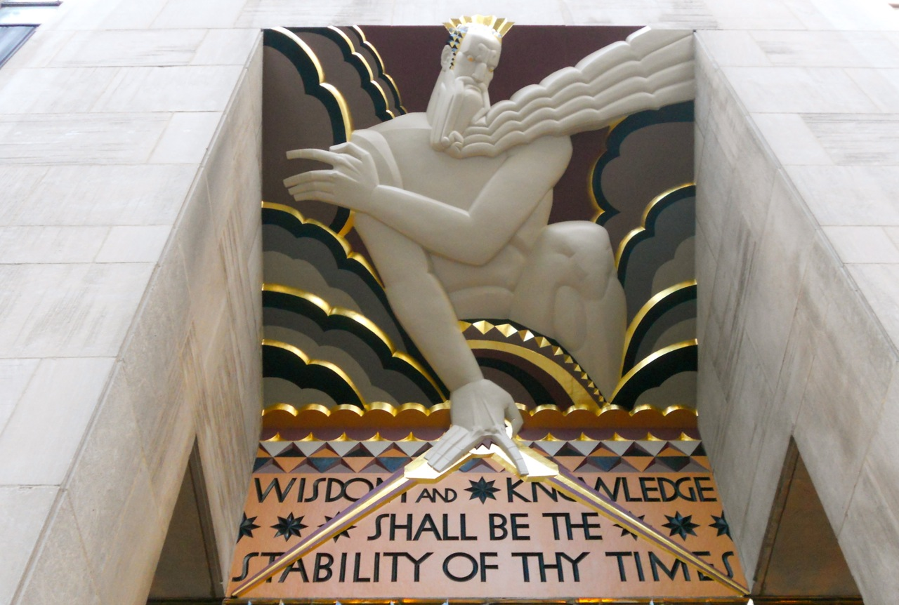 Lee Lawrie,  Wisdom , 1933. Bas Relief Panel on adjoining planes, with text. Entrance to main building to Rockefeller Center. I can't find a precise address, but it's tucked back in the complex, off 5th, south of 50th street.